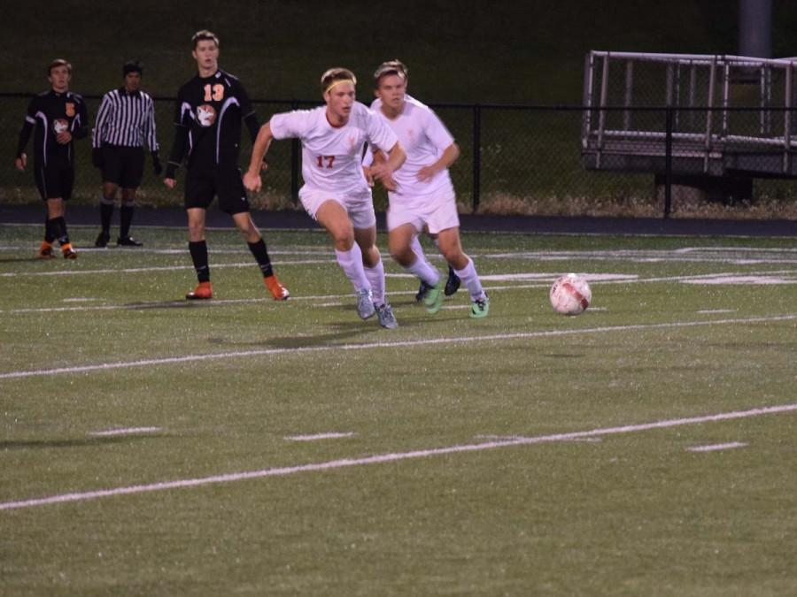 Peter Dilla and Noah Hunter intercept the ball from the opposing team.