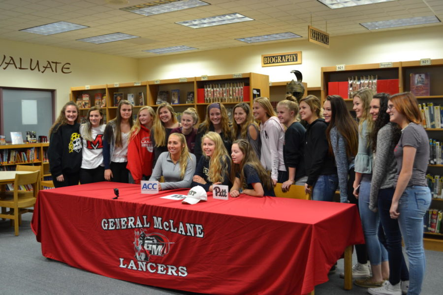 Maddy and the Volleyball Team celebrate her signing.