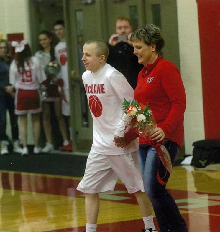 Wags gets escorted by his mom on senior night.