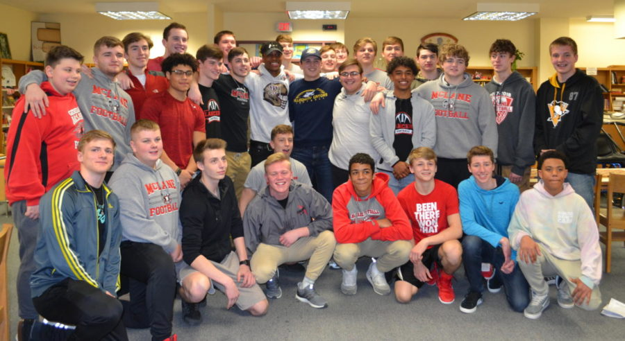 Members of the football team celebrates the signing of their teamates.