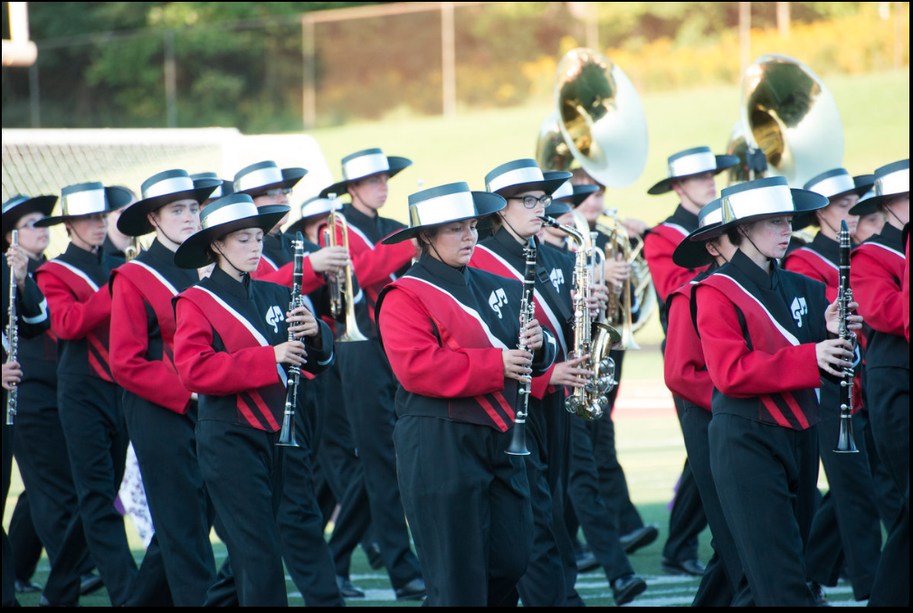 The band performs at halftime at the Homecoming football game.