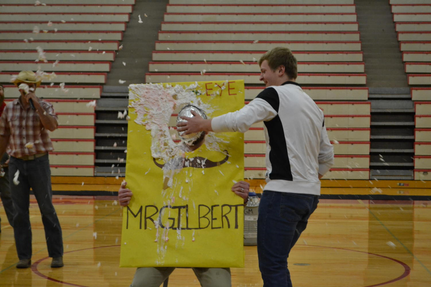 Ben Rea smacks a pie in Mr. Gilbert's face in the name of charity.