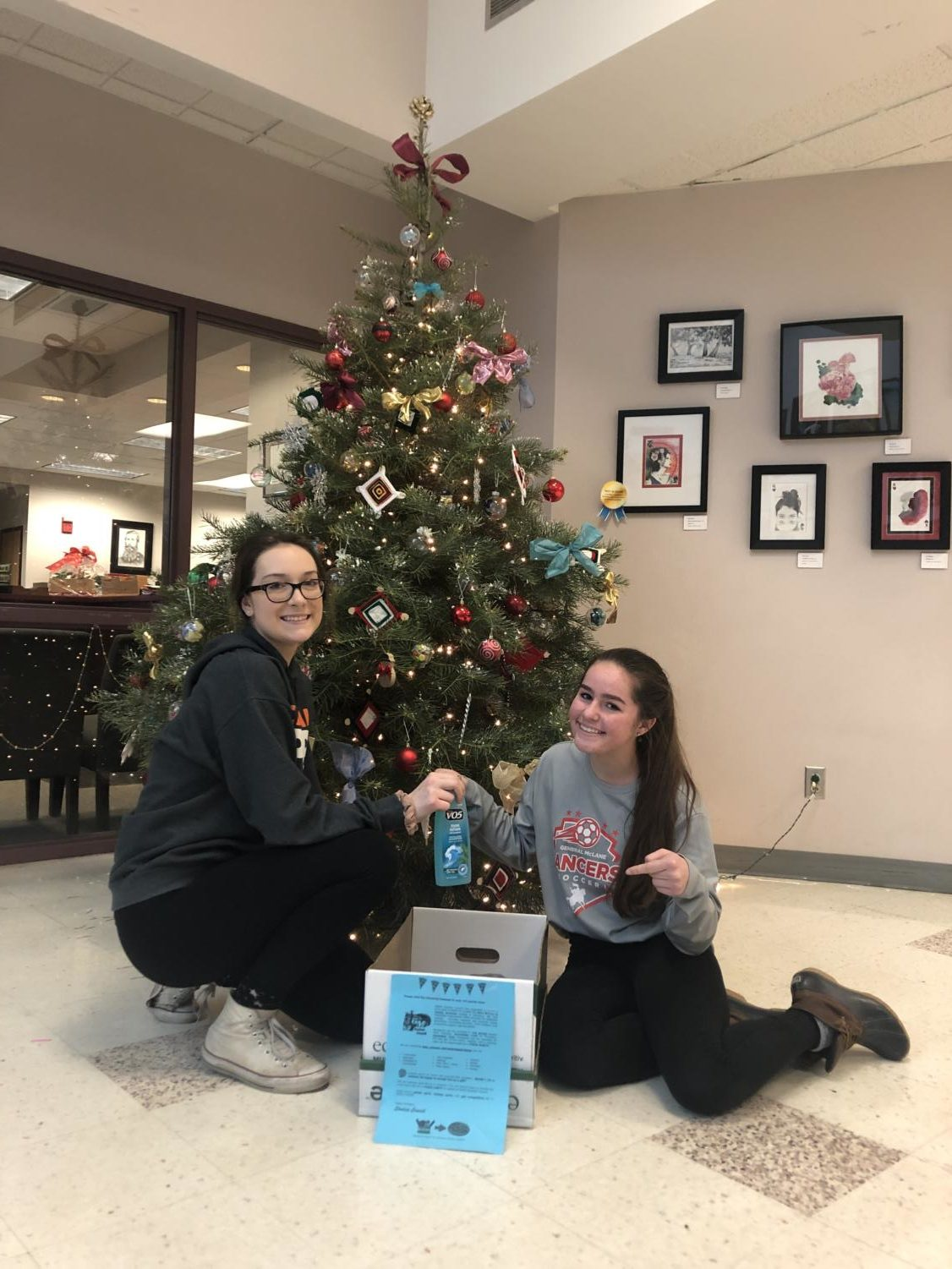 Noel Antalek and Kaley Berger make a donation to  Student Council's fundraiser for the Boro Women's Center.