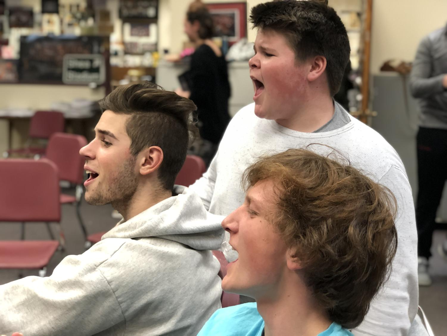 Senior Brennon Songer and juniors Carter Willis and Sam Wagner belt out a tune during Broadway Dinner rehearsals.