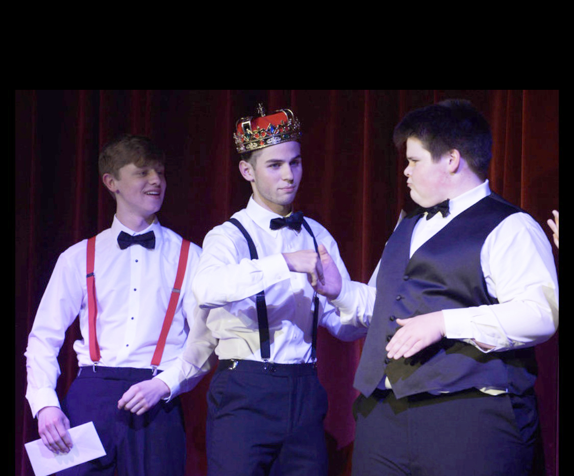 Spencer Conaway and Carter Willis congratulate the 2019 Mr. GM, Brennon Songer.