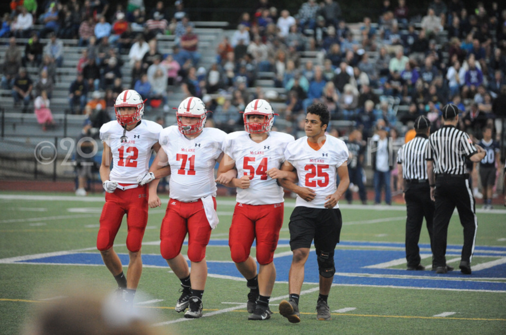 Senior captains Nate Jones, Logan Mitchell, Billy Jukes, and Ben Howe-Jones after the toss at the Oil City game.