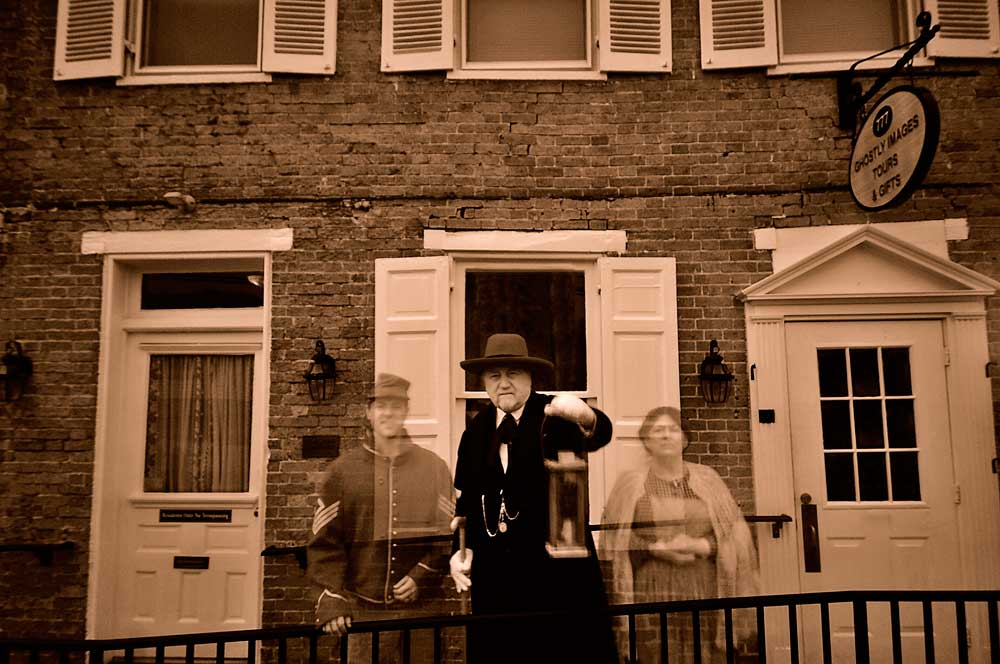 Ghostly figures standing outside of the Ghostly Images Tours.