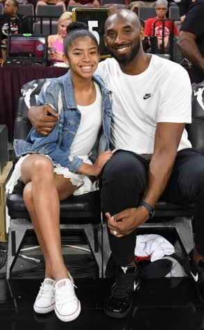 Kobe and Gianna Bryant enjoying a basketball game