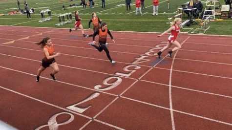 Sydney Rotko racing in the 100M at the Harborcreek meet.